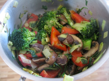 organic broccoli, red bell pepper, shiitake mushrooms, leek, fresh sage, rosemary and cilantro, with olive oil.